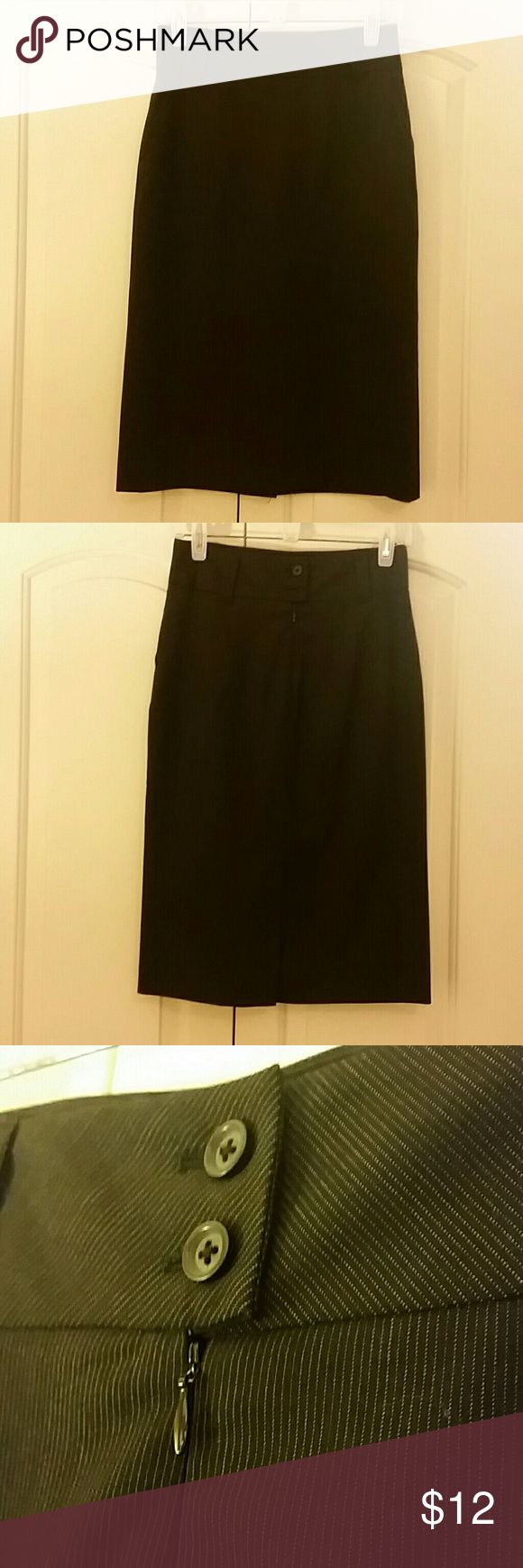 """Banana Republic fitted classic pencil skirt. Black pencil skirt with subtle stripes. Sits at the waist and fitted throughout. Two buttons and zip closure at the back with an 8"""" slit at the bottom. 26"""" length Banana Republic Skirts Pencil"""