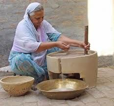 Punjabi virsa (traditional) that object is a 'Chakki' used to turn different kinds of grains to flour.