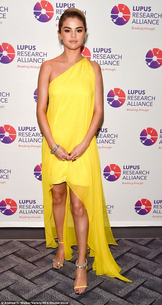 For the cause: Selena Gomez stunned in a yellow sleeveless dress with asymmetrical hem as she attended the Breaking Through Gala benefiting the Lupus Research Alliance Monday