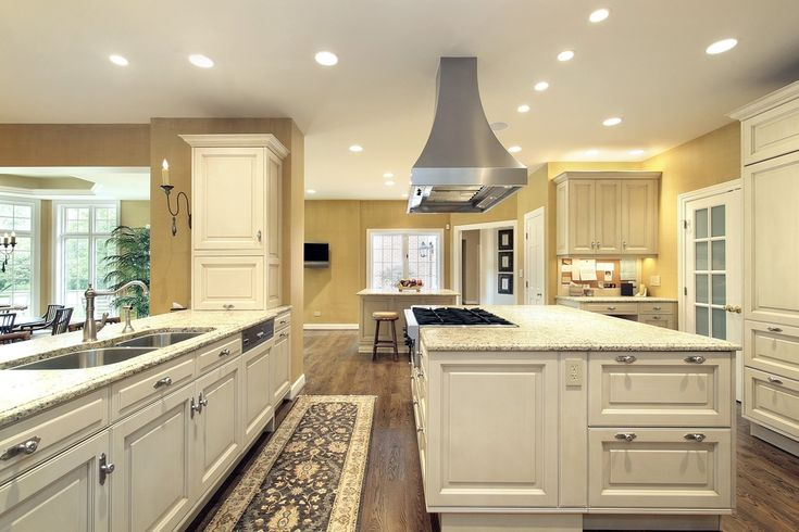 Large bright kitchen with matching island with stove.