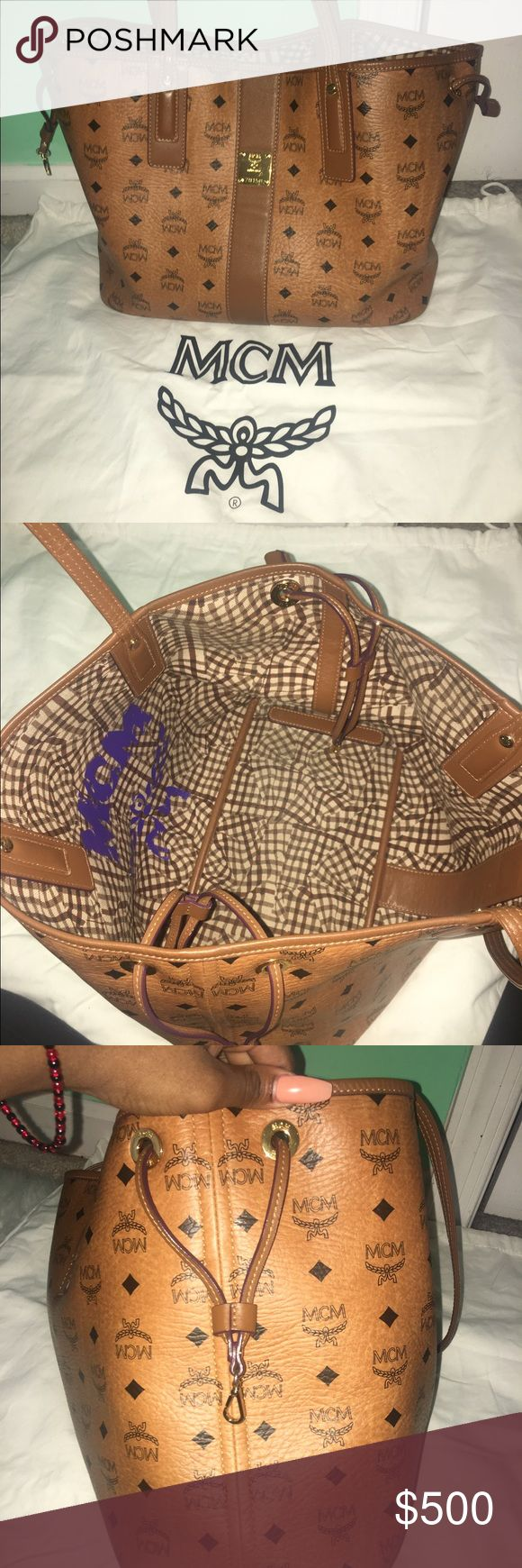 MCM Handbag This MCM tote is soooo beautiful! It's still in great condition! only used a few times. Clutch is included MCM Bags Totes