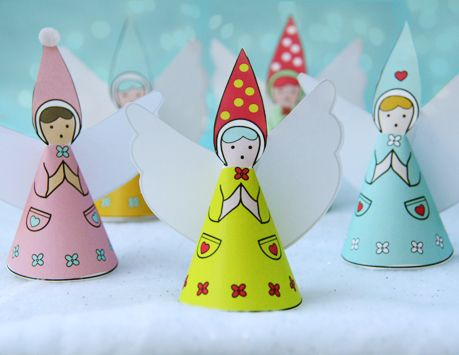 Print and cut out this adorable paper angel ornament.