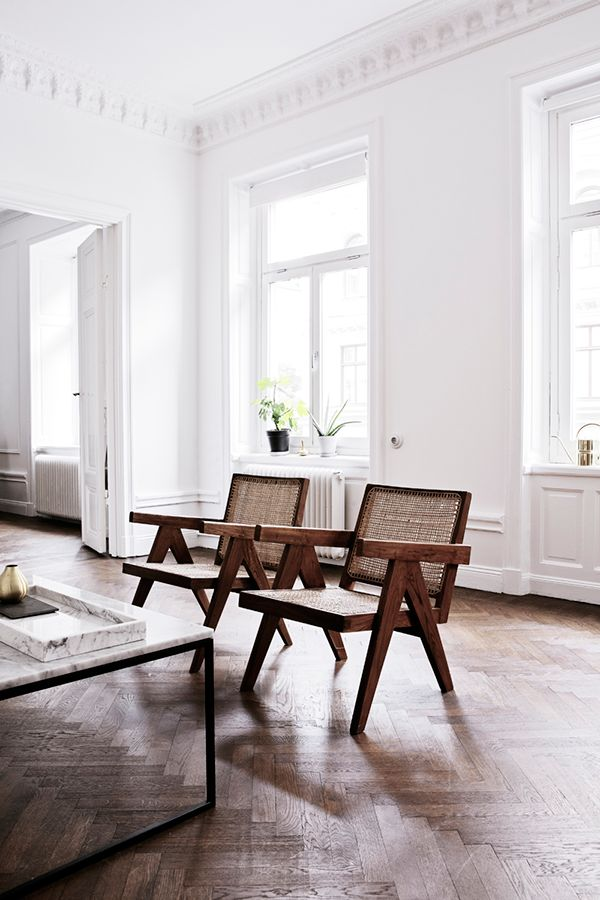galerie maison première. Pierre Jeanneret.  Pair of low chairs, model no. PJ-SI-59-A, Chandigarh , circa 1955, teak and cane