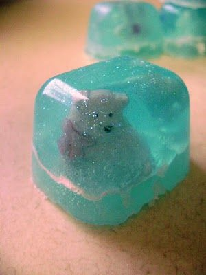 This is kind of like the snow globe soap idea I was thinking of trying for MOPS in December (one to take home, one to give to MOPPETS).  These are small, use buttons in an ice cube tray.  I'm still thinking bigger size and maybe a soap center manger or gingerbread man or snowflake or ...