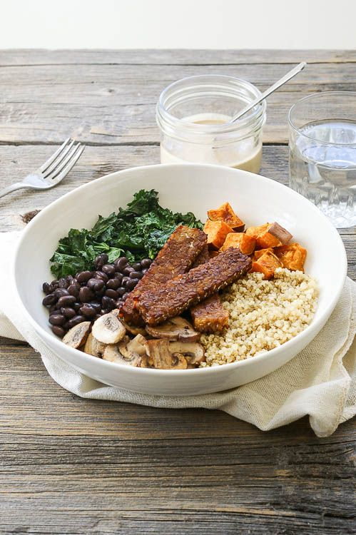 This tempeh quinoa power bowl drizzled with a dreamy lemon tahini sauce is a healthy meal packed with vegan protein!