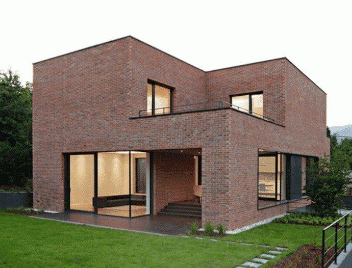 Fachadas de casas con ladrillos rasados