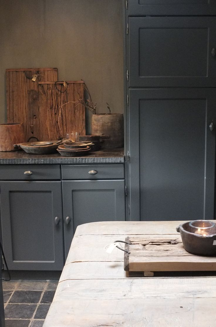 soft deep country blue kitchen with beautiful soapstone countertop edge -article on Kitchen Styling & Living showroom