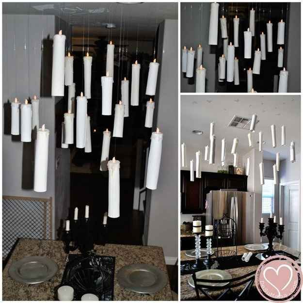 Make floating candles out of paper towel rolls and flameless tea lights. | 33 Cheap And Easy Ways To Throw An Epic Harry Potter Halloween Party
