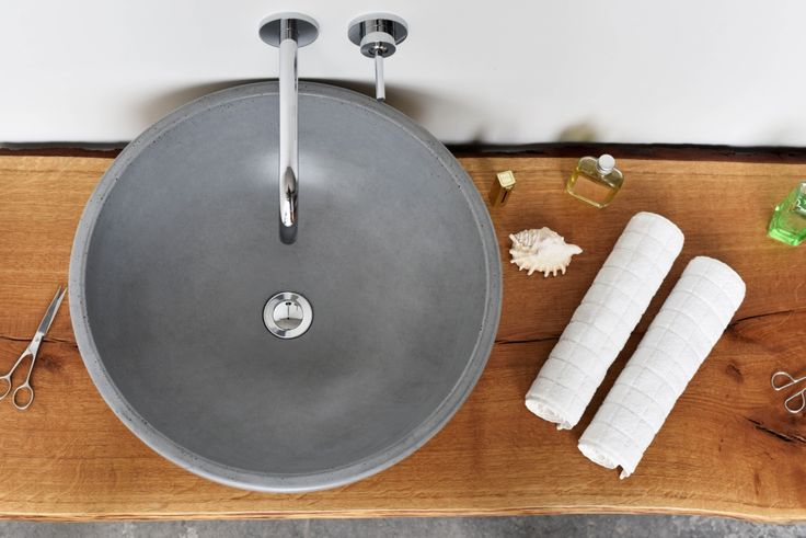 Concrete washbasin Gravelli Orb in grey variant.