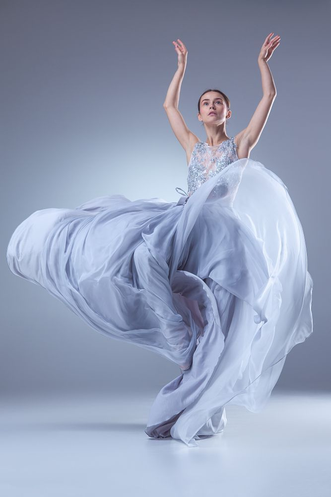 The beautiful ballerina dancing in blue long dress by Volodymyr Melnyk on 500px