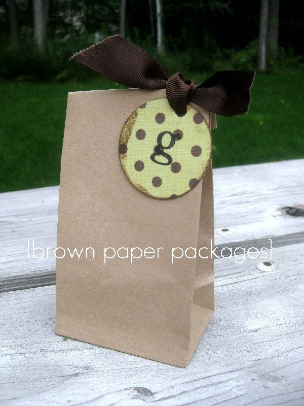 """It's the small touches that make something extra special... used my stamp to add the """"g"""" to a piece of scrapbook paper that I punched with my 2 inch circle punch, then tied it on using brown grosgrain ribbon."""