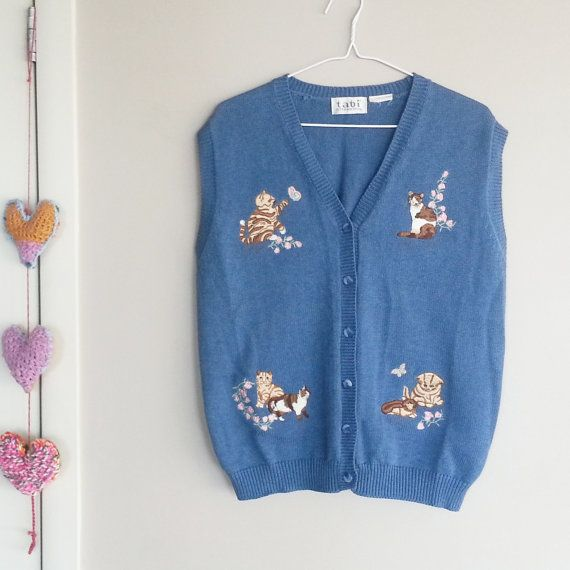 Check out this item in my Etsy shop https://www.etsy.com/ca/listing/267352991/kittens-sweater-vest-vintage-sweater