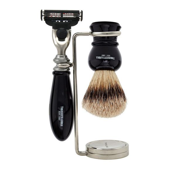 Regency Collection. Truefitts' traditional regency style shaving set comprising a matching brush, razor and stand. Available in three styles, Faux Ebony, Faux Ivory, and Faux Horn. Made in the UK and beautifully finished by hand with a perfectly balanced razor and hand made super badger shaving brush. Suitable for use with the Mach III blade.