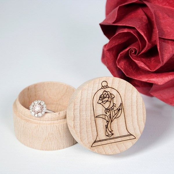Keep your rings safe in this gorgeous wooden ring box from BespokeLaserUK on Etsy, which is engraved with the enchanted rose from Beauty and the Beast. In fact, even before you get married, we think it's perfect for a Beauty and the Beast themed wedding proposal.