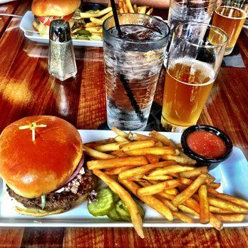 Bru Burger Bar - Indianapolis, IN, United States. Lamb burger with feta/olive and cucumber sauce, run through the garden. I would run through anything to eat this!!