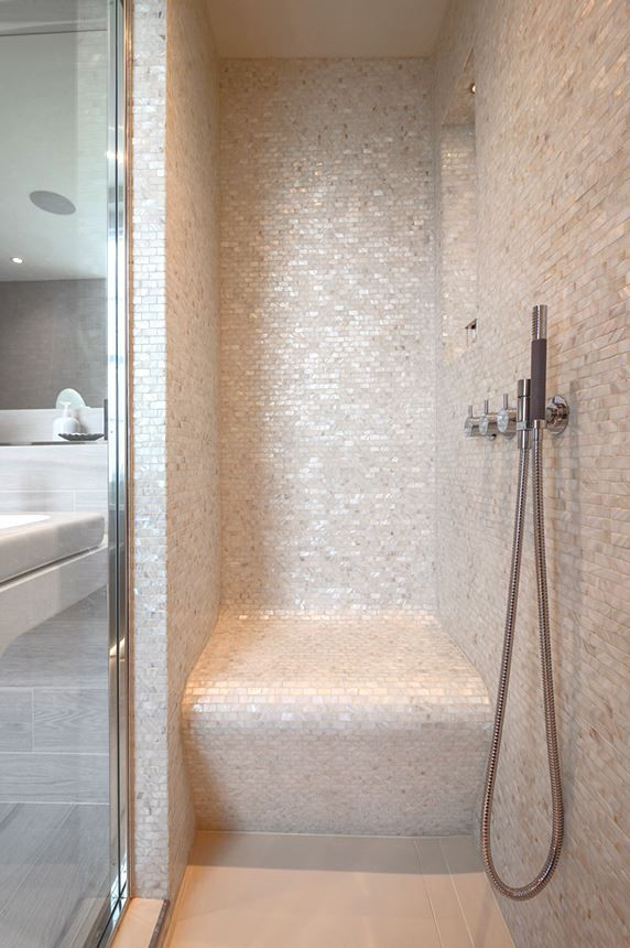 Designed by Monita Cheung. Installed by Dragonfly London Limited. Photographer Nikhilesh Haval. Modern Bathroom - steam room, mother of pearl mosaics, Vola brassware, Effegibi steam door, Hayon basin and vanity top and Starck washlet WC.