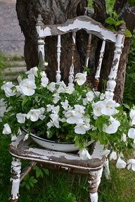 Old Rustic Chair with chippy old dish pan full of flowers is just my style.... Love this!