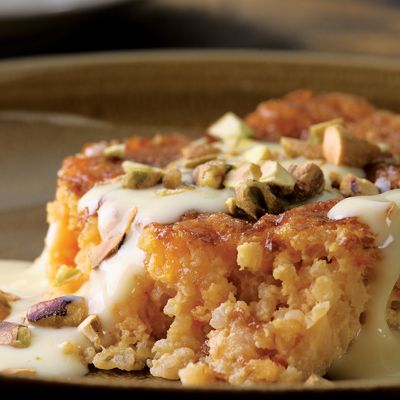 """Don't be put off by """"bulgur"""" and """"cake"""" in the same title. (Think rice pudding but with bulgur.) Whether you use coarser-textured bulgur (our preference) or fine, the cooked bulgur (Step 1) should resemble cooked oatmeal. Recipe: Apricot-Bulgur Pudding Cake with Custard Sauce"""
