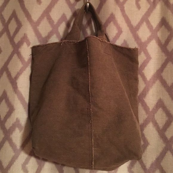 Large soft canvas gap tote Soft, brown large tote, short handles. Fits everything, one inside zipper pocket, one inside slip pocket and a pen pocket GAP Bags Totes