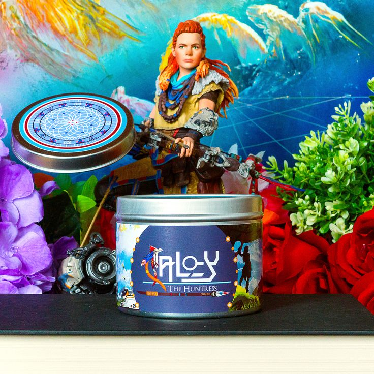 Aloy from Horizon Zero Dawn sitting on her inspired scented candle by Happy Piranha. Instagram by @rainbow.literarian.  #bookstagram #HorizonZeroDawn #HappyPiranha #PS4 #Playstation #Aloy #Huntress #candles #scentedcandle #candle #dreamhome #geekyloot #gamergift