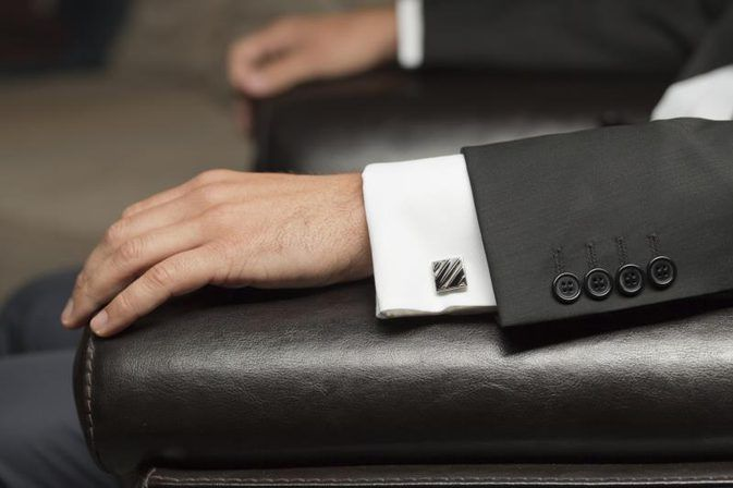 #Cufflinks can be worn with single cuffs or with doubled-back cuffs. The double-back cuffs have two holes on either side of the opening, which should line up one atop the other. http://alzillazgaming.com/what-materials-are-used-for-cufflinks/