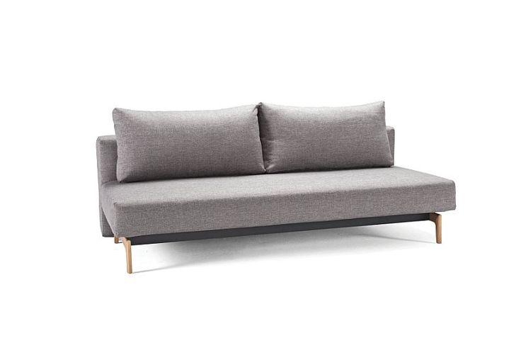 Sovesofaen Trym, er en klasisk flot sofa uden armlæn, hvor sovekomforten er i top. Perfekt til din stue, lejlighed eller overnattende gæster. Fås i farverne mørk brun eller grå samt med lakerede træben og sort stel.