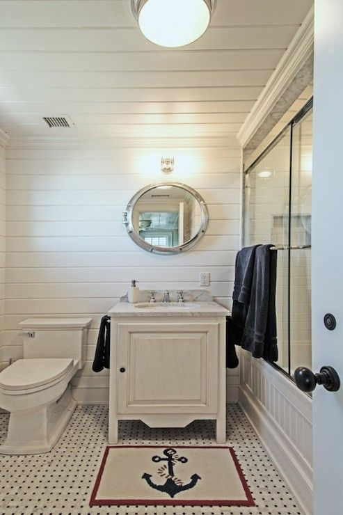 Whitewashed bath vanity cabinet,  light grey top, white walls and chrome fixtures