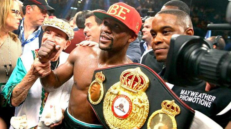 "Boxing - ""Floyd Mayweather Jr."" - Announces his rematch against 'Maidana' - Fight is set for Sept. 13, 2014 - This pic signifies his win w/championship belt after defeating Marcos Maidana on May 3. Mayweather's record is 46 wins, 26 by KO in the welterweight division while Maidana has 35 wins (31 KOs) and 4 losses. The fight will take place at the MGM Grand in Las Vegas..."
