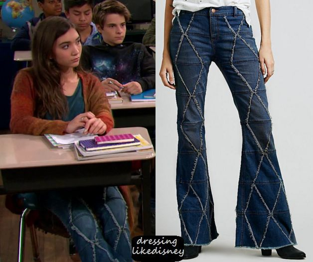 "Riley Matthews (Rowan Blanchard) wears these blue flared diamond distressed detailed jeans in this episode of Girl Meets World, ""Girl Meets the New Year"".    They are the Free People Tyler Pieced Flared Jeans."