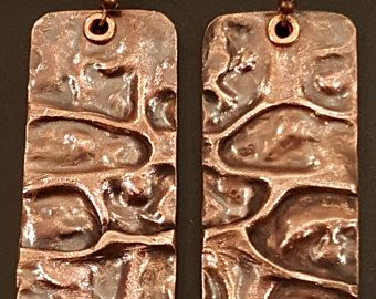 Air Chased Pure Copper Earrings Dangles with antiqued patina finish and copper rivets - http://olgadriscoll.com/product/air-chased-pure-copper-earrings-dangles-with-antiqued-patina-finish-and-copper-rivets/