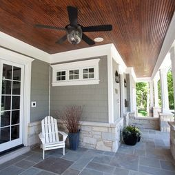 Bell jar outdoor ceiling fan with wood stained ceiling on porch