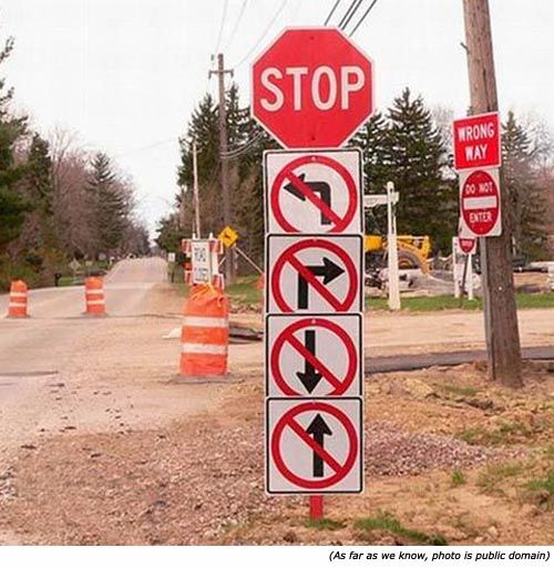 Hilarious signs and funny traffic signs: STOP. No left turn. No right turn. No going back. No going forward.