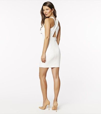 This white crossed back dress calls for instant chic this summer!
