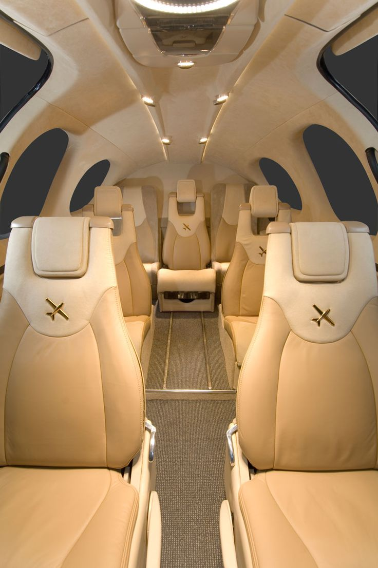Private jet interior furnished like a vintage train aviation -  Cirrus Vision Private Jet
