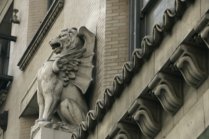 An ornate gargoyle peers over 5th Street on the Alexandria Hotel downtown Los Angeles Thursday, Oct. 20, 2005. The city is considering a 50 million subsidy to developers who want to renovate the Alexandia Hotel, the biggest residential hotel in downtown, in an effort to keep the units as affordable housing amid the explosion of high�end condos downtown. The 512�unit Alexandria was once one of the city's grandest hotels with its 60�foot�high lobby of Italian and Egyptian marble and…