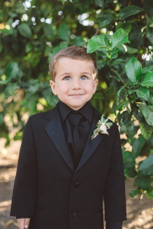 such a dapper dude in black on black, and just look at those big blue eyes!
