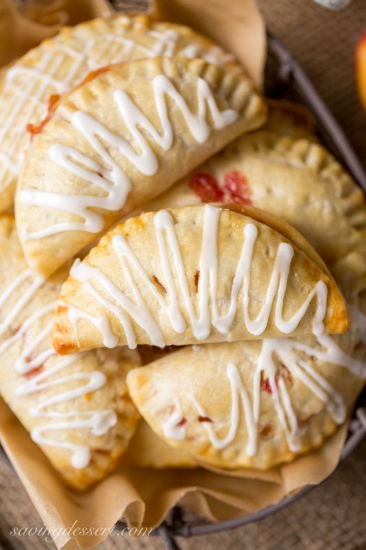 Peach Hand Pies - juicy, sweet peaches wrapped in a flaky crust and topped with an almond flavored drizzle!