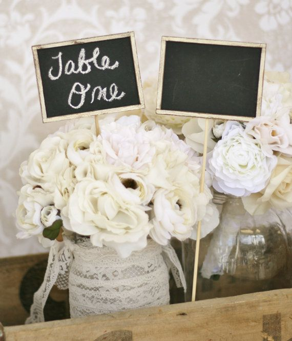 tables - very cute use of a chalkboard for centerpieces and table numbers