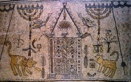 A synagogue-panel detail from the ancient kibbutz Beth Alpha mosaic with sacred Jewish symbols: the Ark of the Covenant, eternal light, a menorot, a palm frond, citron and an incense shovel.