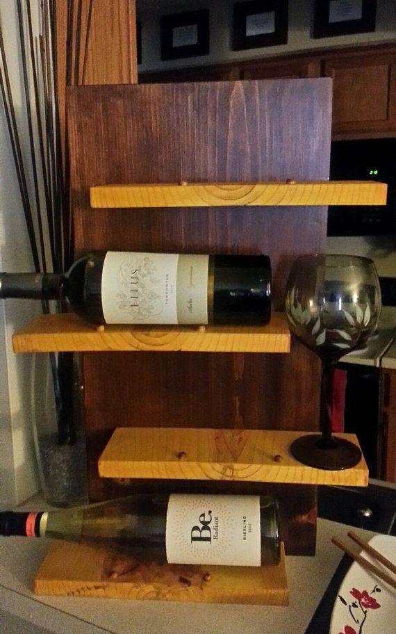 Handcrafted wine bottle shelf. Available at www.etsy.com/shop/nobletimber.