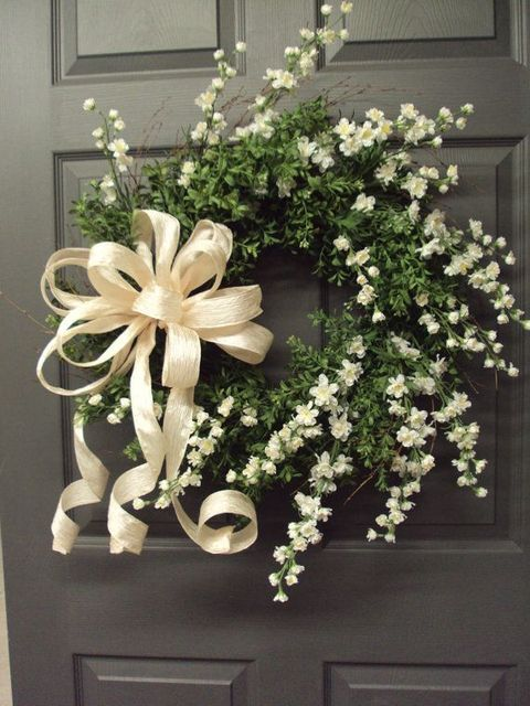 A wedding wreath is a cute and simple idea for wedding decor, for any theme and season. Lush floral, fir branches, greenery and leaves...