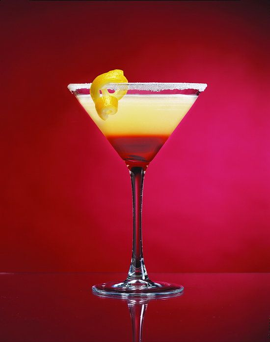RASBERRY LEMON DROP MARTINI  1 1/2 oz cirtrus vodka   3/4 oz Triple Sec  1/2 oz Chambord Liqueur  1 oz Sweet & Sour mix  Juice from two lemon wedges  lemon twist & sugar for rimming glass