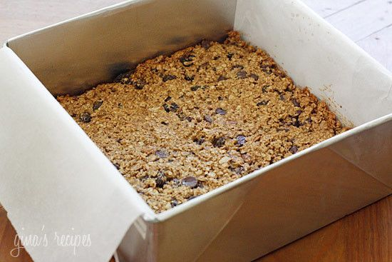 Moist and Chewy low fat granola bars loaded with chocolate chips, raisins and pecans in every bite. Perfect for breakfast or an afternoon snack.  You're probably wondering why I am posting so many baked recipes in this heat but I am having some work done to my house and it's really hard to cook around here this week. I made these last week knowing things would be chaotic around here... you are going to love these!!!   I cut them in long bars like the granola bars you buy in the store...