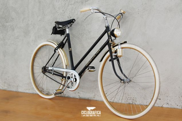 "This Ciclografica bike is built around the theme, ""Love comes, love goes."" It looks better on the frame printed in Italian with gold Art Deco script."
