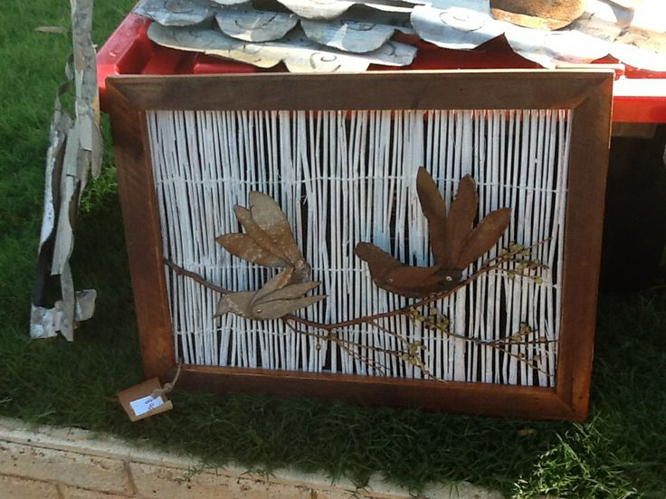 Birds made from fencing materials, background, old reed screen and frame up cycled pallet.