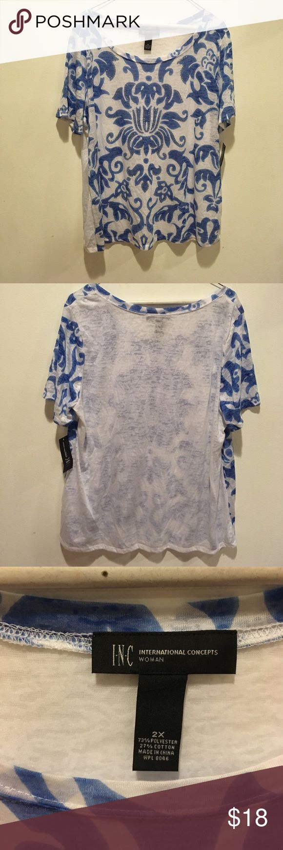 Blue and white short sleeve Blouse Pretty blue and white pattern with rhinestone embellishments in the front.   The back of the shirt is white.   Very comphy! INC International Concepts Tops Blouses