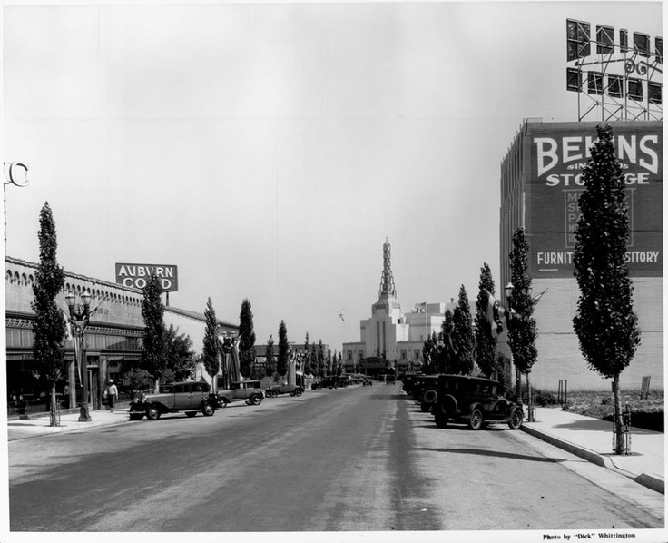 A beautiful shot of Canon Drive just North of Wilshire Blvd., in what appears to be the mid 1930's. The Warner Beverly Theater is seen at the center of the photograph and the Art Deco, glass brick waterfall design (out of view), Bekins storage building shown on the right.