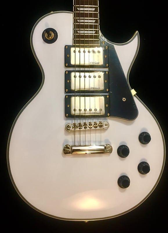 Vintage V1003aw Arctic White 3 Humbucker Electric Guitar W Gold Hardware Amp D Guitars Reverb Electric Guitar Guitar Guitars For Sale