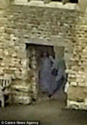 Creepy: Dean and Amy Harper believe their picture (close up right and circled left in yellow) shows the 'Grey Lady' who has supposedly haunted Dudley Castle in the West Midlands for centuries