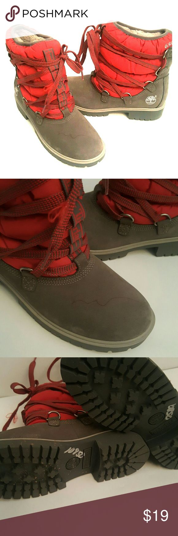 Timbaland boots They are grey and red with a red pen mark on top of the right shoe as well as a flawed shoes lace on the right.  In good condition. Shoes Lace Up Boots